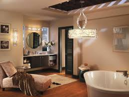beige painted wall wooden tile flooring freestanding bathtub beautiful hanging shade lamp beautiful wall sconce lamps