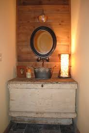 rustic black wood frame. Interior. Oval Mirror With Black Wooden Frame Placed On The Brown Wall Plus Rustic Wood D
