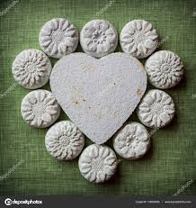 Flower Paper Mache Heart And Flowers Made Of Paper Mache On A Fabric Background Stock