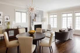 beige leather dining chairs with round brown dining table