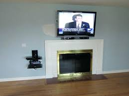mounting a tv above a fireplace hiding wires mount on brick fireplace hide wires part