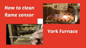 goodman furnace flame sensor. furnace maintenance. kitchen sponge can clean flame sensor. goodman furnace sensor