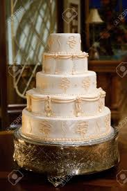 Classic Wedding Cake With Gold Icing Stock Photo Picture And
