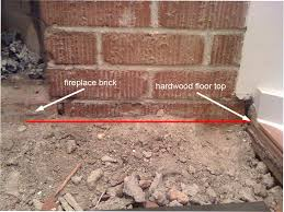 do i need to build something in front of the firebrick to stop embers from coming out or will a fireplace grate be enough after the hearth is done