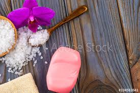 white bath salt in a wooden bowl with a spoon soap burlap and
