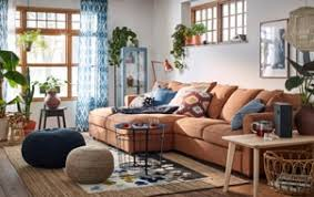 a cozy and warm beige blue and brown living room with grÖnlid 4 seat