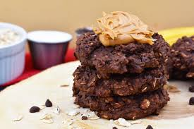 these healthy cookies are made with oats peanut er banana and cocoa powder sweetened with monk fruit and include chocolate protein powder for a