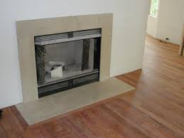 the marble fireplace surround in place with hearth framed by cherry