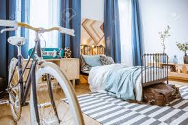 Bed With Lights Close Up Of Bicycle In Blue Bedroom Interior With Drapes And