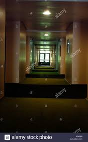 hotel hallway lighting. architecture corridor hallway hall lights long walls carpet dark hotel office apartment building concept perspective stock lighting g