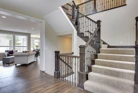 1 tag Traditional Staircase with Hardwood floors, High ceiling