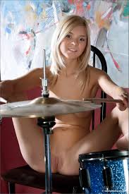 Naked girl playing drums