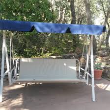 white patio swing with blue canopy for outdoor decor idea