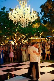 here are a few dazzling ways to incorporate chandeliers into your outdoor nuptials