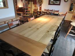 trestle table made from tiger maple with cherry base includes 2 12 company boards as extensions made by moran woodworks 7 long x 41 wide x 30 high
