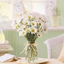 Easy, and perhaps obvious, use for Mason jars, as a vase for a bouquet of  flowers. Of course you could use any type of flower and it would look  pretty, ...