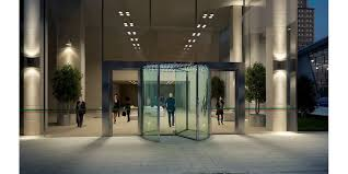 assa abloy rd300 all glass revolving door at night