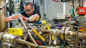 argonne researcher jim sevik tightens the fuel rail on a natural gas direct injection system