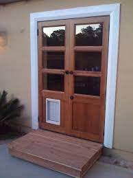 32 x 80 exterior door with pet door. custom french doors were designed to match client \ 32 x 80 exterior door with pet