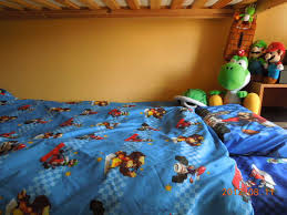 he looooves super mario so we gave him the whole mario kart bedset he completes his room with mario figures plush poster tissue box turtle s