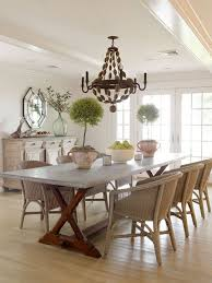 zinc top table paired with unexpected wicker chairs eclectic mix wicker kitchen table and chairs
