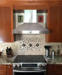 tile backsplash designs behind range kitchen stove kitchen range and ...
