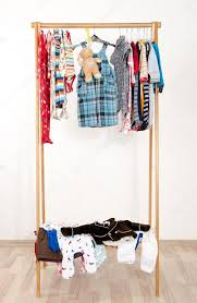 colorful wardrobe of newbornkids toddlers babies on a rackmany tshirtspants shirtsblouses onesie hanging messy clothes thrown shelf u2014 photo kids messy closet a33 messy