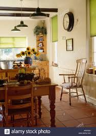 Terracotta Floor Kitchen Pine Table And Chairs In Kitchen With Terracotta Tiled Floor And