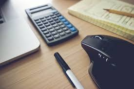 a modern desktop with a mouse and calculator services