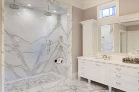 marble master bathroom. traditional master bathroom with dual showerhead rainfall shower and white marble