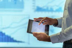 Man Using Business Digital Tablet During Presentation With Graphs And D943_247_841