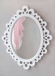 oval mirror in a white wooden frame with lace designs