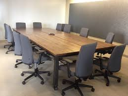 conference room chairs with casters. Varnished Oak Wood Conference Table Mixed Black Acrylic Chairs Room With Casters