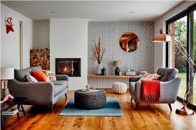excellent design absolutely gorgeous mid century living rooms wooden floor blue rug round table brown sofa orange and motif cushions standing lamp fireplace