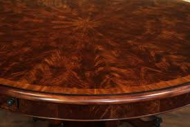 classic multi banded flame mahogany dining table shown opened to 74 inches and seats 8