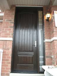 rustic door woodgrian solid single front door with frosted side lite installed by front entry
