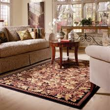 if you love the look of area rugs in a room you re not alone deciding on the size of the rug can be perplexing though should it fill the room or be