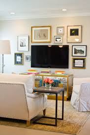 of all the tv gallery walls i ve seen in pics this one feels perfect lauren haskett houston interior design 2