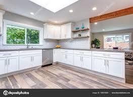 Open Concept Kitchen White Cabinets Grey Quartz Countertops Tile