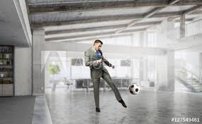 Playing Office Soccer Mixed Media Buy This Stock Photo And