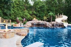 backyard pools with waterfalls and slide. Wonderful Waterfalls To Create The Island Theme Girner Added All Elements On  Homeownersu0027 Wish List Including A Custom Waterslide 70footlong Lazy River Waterfall  Backyard Pools With Waterfalls And Slide S