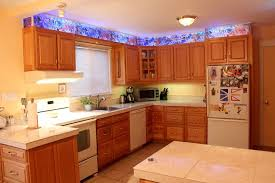 picture of kitchen cabinet faux stained glass and led lighting