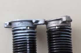 garage door spring repairHow to Replace Garage Door Torsion Springs