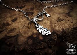 handcrafted silver oak leaf charm for a tree sculpture necklace or bracelet