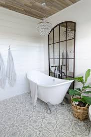 Image House The Plank Ceiling Shiplap Walls Grid Mirror Cement Tile And Raindrop Chandelier Provide Perfect Backdrop For My Doubleslipper Tub Home Stories To Urban Farmhouse Master Bathroom Remodel