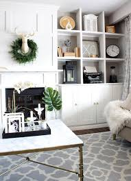 built in shelving around a fireplace with cubbies for elegant living room storage 1 1