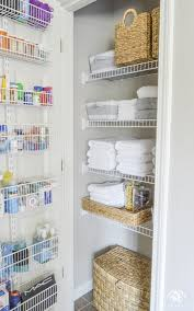 a beautifully organized bathroom linen closet via kelley nan uses the door for some amazing extra storage and baskets keep smaller items neatly grouped on