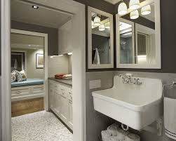 lovely gray laundry room design with gray walls paint color gray subway tiles backsplash utility sink marble mosaic tiles floor and light gray cabinets