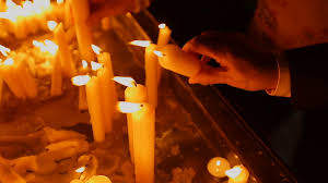 people lighting candles at memorial place sorrow and pain at the church stock footage blocks