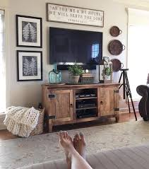 long living room wall decorating ideas. decorating around tv...something long and narrow above different height/shape living room wall ideas